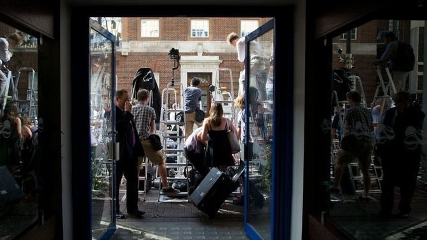 Media wait outside The Lindo Wing of Saint Mary's Hospital in Paddington, west London on July 22, 2013. The London hospital hosting Prince William's wife Kate was the scene of a media frenzy today after weeks of waiting for the royal baby.
