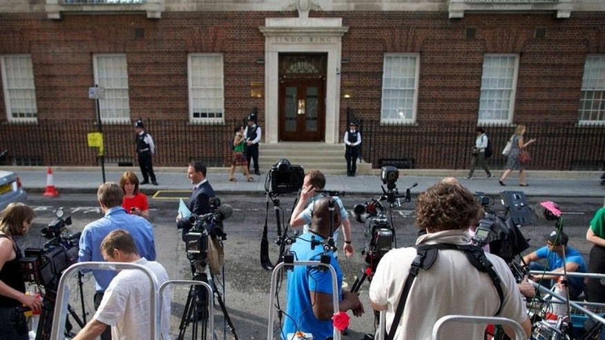 Media wait outside The Lindo Wing of Saint Mary's Hospital in Paddington on July 22, 2013. Prince William's wife Catherine has been admitted to a private wing of the London hospital, to give birth to her first child.
