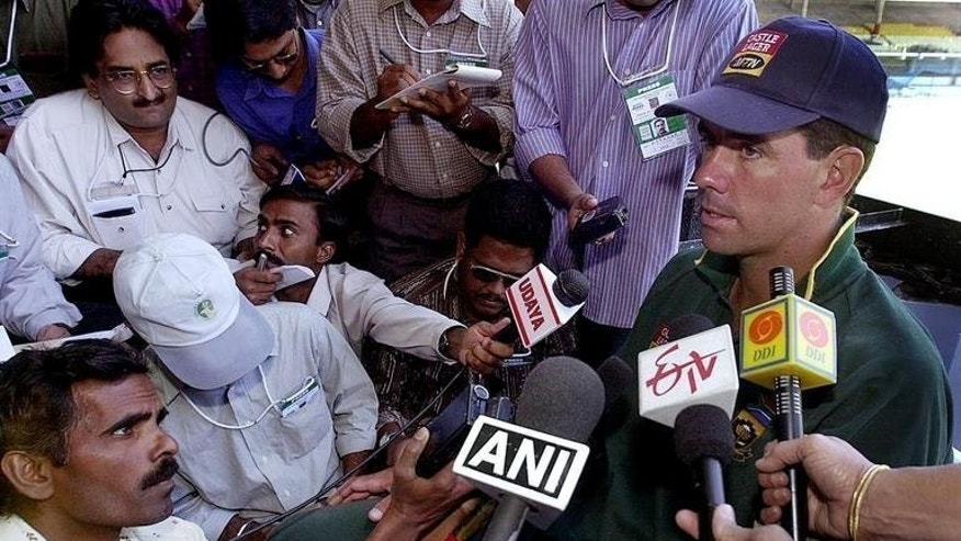 Then South Africa cricket captain Hansie Cronje (R) speaks to reporters after a practice session in Bangalore, southern India on March 1, 2000. Indian police filed charges on Monday over the 2000 cricket fixing scandal involving the late South African captain Cronje, an officer said.