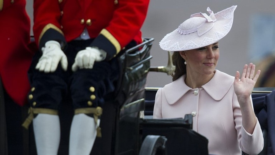 Catherine Duchess of Cambridge rides to Buckingham Palace after the Queen's birthday parade in London, June 15, 2013. Kate's pregnancy has seen her endure illness, media frenzies, bikini shot scandals and a prank that ultimately ended in tragedy.