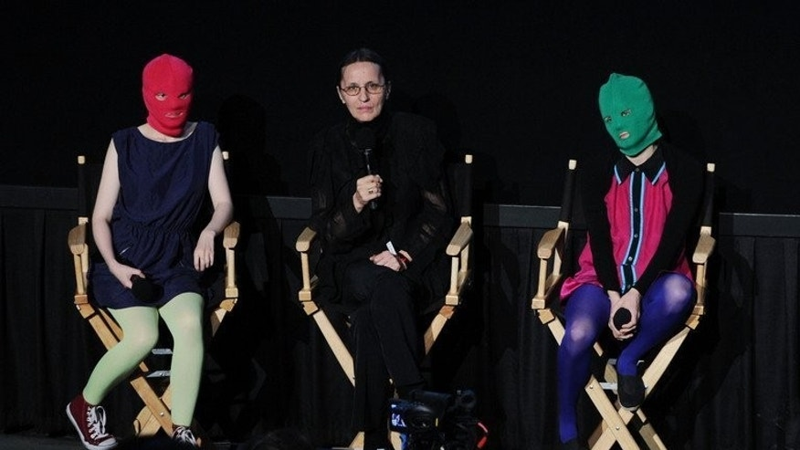 Headlights (L) and Puck (R) from 'Pussy Riot' speak at an event on June 5, 2013 in New York City. More than 100 famous musicians including Madonna, Elton John and Sting are calling for Russia to release two members of the feminist punk-rock band, jailed for an anti-government protest performance.