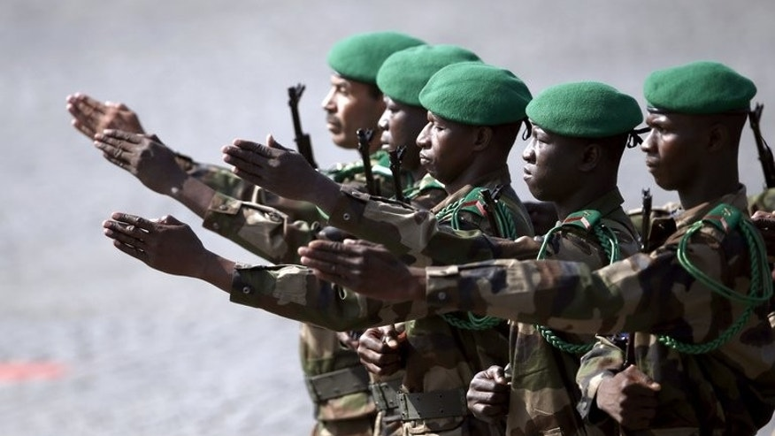 Malian troops march during the Bastille Day parade on the Champs Elysees, on July 14, 2013 in Paris. Tuareg rebels held talks with Mali's interim president, discussing possibilities for peace and reconciliation, but tensions remained high as a homemade bomb was found in flashpoint city Kidal a week from a crucial presidential vote.