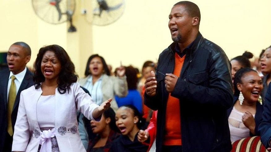 "Mandla Mandela, one of Nelson Mandela's grandsons, attends a church service in Durban on July 21, 2013. Former South African president Nelson Mandela is ""steadily improving"" six weeks after he was admitted to hospital with a recurring lung infection, his grandson said."