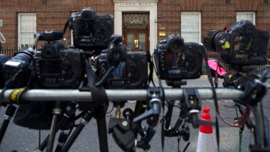 Remote cameras focus on the door of The Lindo Wing of Saint Mary's Hospital, London on July 22, 2013. The hospital hosting Prince William's wife Kate was the scene of a media frenzy after weeks of waiting for the royal baby -- while tourists kept an eye out for a big announcement at Buckingham Palace.