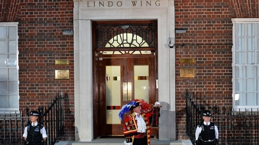 Town Crier Tony Appleton stands outside the Lindo Wing of St Mary's Hospital, on July 22, 2013 to announce the birth to Prince William and Catherine Duchess of Cambridge of a baby boy. Britain's new baby prince follows his father and late grandmother by being born under the zodiac sign of Cancer, suggesting he will be a strong leader, according to astrologists.