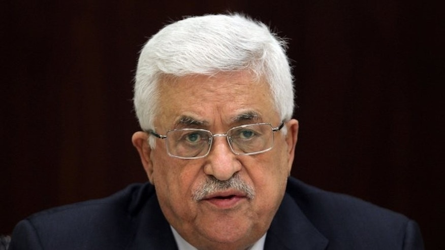Palestinian president Mahmud Abbas chairs a meeting in Ramallah on May 12, 2013. Abbas has said any future peace deal with Israel will be put to a referendum, in remarks published four days after Washington announced the resumption of negotiations.