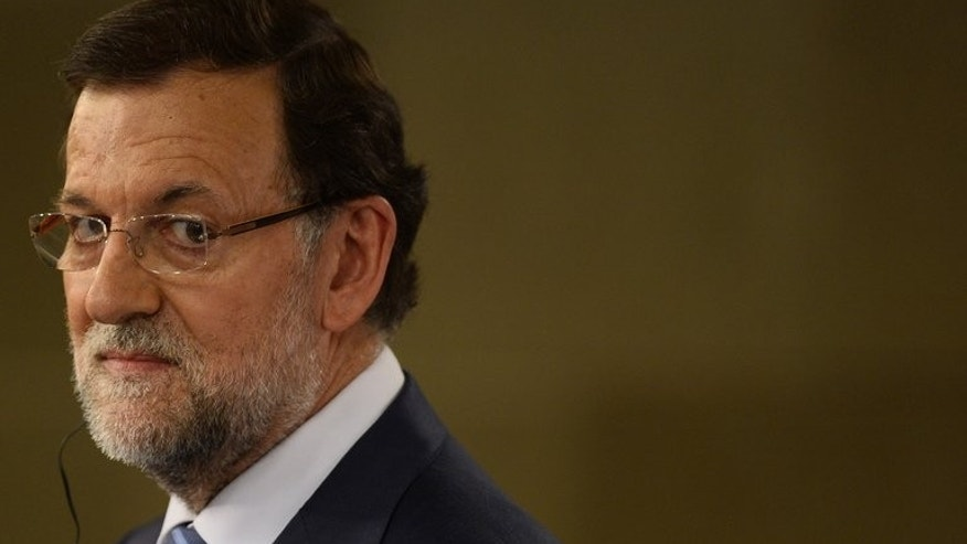 Spanish Prime Minister Mariano Rajoy looks on during a press conference in Madrid, on July 22, 2013. Rajoy, under fire over a corruption scandal, says he will appear in parliament in the coming days to explain the political situation of the country.