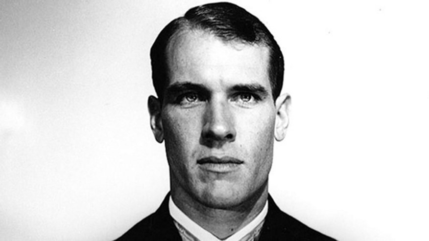 This undated file photo provided by the U.S. Navy, shows Thomas Hudner who received the Medal of Honor for crash-landing his plane and trying to save Jesse Brown, his wingman, who went down behind enemy lines during the Korean War. Two years after he made history by becoming the Navy's first black pilot, Ensign Jesse Brown lay trapped in his downed fighter plane in subfreezing North Korea, his leg broken and bleeding. His wingman crash-landed to try to save him, and even burned his hands trying to put out the flames. A chopper hovered nearby. Lt. j.g. Hudner could save himself, but not his friend. Hudner heads to Pyongyang on Saturday, July 20, 2013 with hopes of traveling in the coming week to the region known in North Korea as the Jangjin Reservoir, accompanied by soldiers from the Korean People's Army, to the spot where Brown died in December 1950. (AP/U.S. Navy, File)