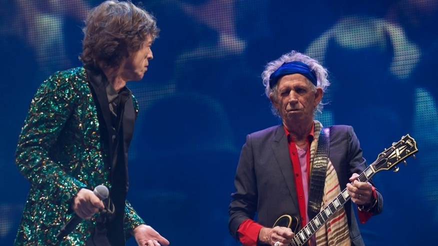 Rolling Stones' Mick Jagger (L) and Keith Richards perform on the Pyramid Stage, on the fourth day of Glastonbury Festival, southwest England, on June 29, 2013. Jagger will celebrate his 70th birthday Friday, his ecstatic reception last month at the Glastonbury Festival still ringing in the ears, as just one of a generation of wrinkly rockers determined not to go quietly.