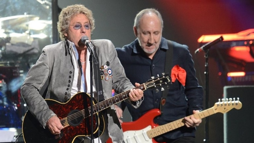 "Roger Daltrey (L) and Pete Townshend of The Who perform during ""12-12-12 The Concert For Sandy Relief,"" on December 12, 2012, at Madison Square Garden in New York. Daltrey, 69, and Townshend, 68, still tour and last year closed the London Olympics with crowd pleasers Baba O'Riley and ""My Generation."""
