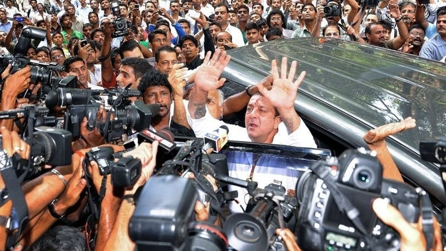 Indian Bollywood actor Sanjay Dutt (C) arrives at the special Terrorist and Disruptive Activities (TADA) court in Mumbai, May 16, 2013. Dutt, who is in jail for arms possession, has lost his final appeal against a decision by the Supreme Court to uphold his conviction.
