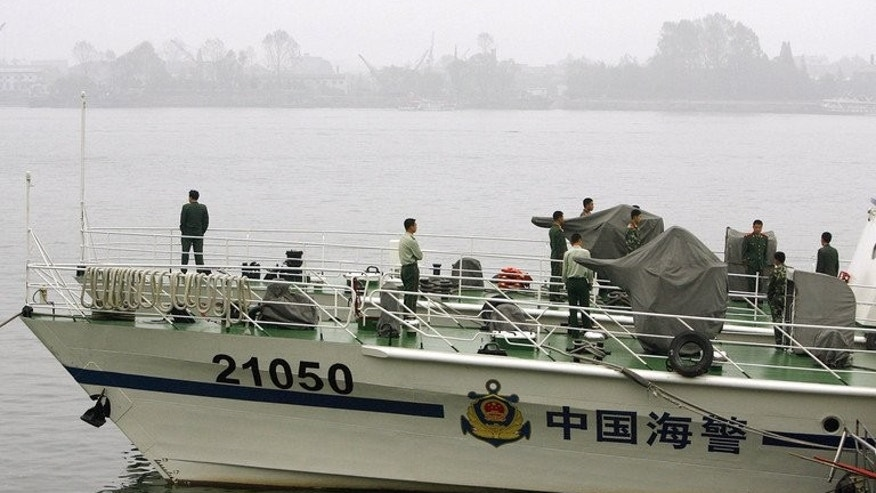 A Chinese coast guard boat patrols along the Yalu River near the border city of Dandong, on October 16, 2006. China's new unified coast guard agency has gone into operation, amid maritime disputes with its neighbours, with experts predicting that more ships will be armed as a result.
