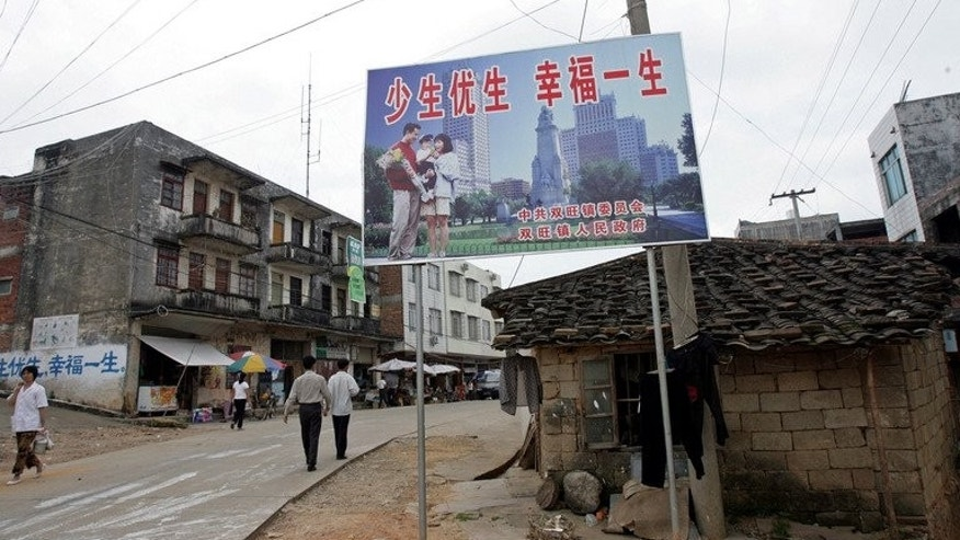 "A Chinese ""one-child"" policy billboard saying, ""Have less children, have a better life"" greets residents in Shuangwang, Guangxi region, on May 25, 2007. A knife-wielding man has stormed an office enforcing China's one-child policy, stabbing two officials to death and injuring four people after a row over his offspring."