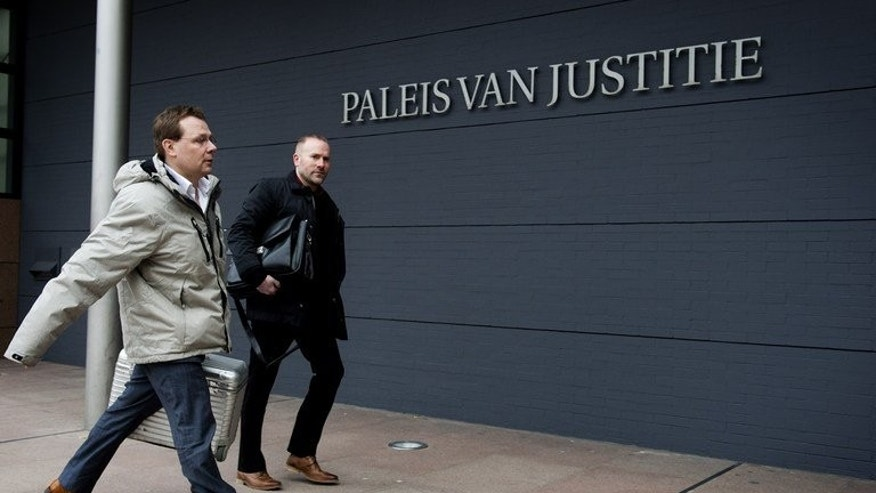 Dutch lawyer Andre Seebregt (left) arrives at a courtroom in The Hague, on February 12, 2013. Seebregt -- who represents Dutch-Pakistani Al-Qaeda suspect Sabir K -- is trying to stop his client's extradition to the United States. A Dutch court has blocked Sabir K's extradition to the US, saying there were unanswered questions about the US role in his alleged torture in Pakistan.