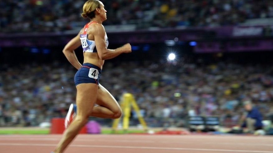 Britain's Jessica Ennis-Hill competes at the London 2012 Olympic Games on August 4, 2012. She said she was competing in pain but was nevertheless determined to compete at next month's World Championships.