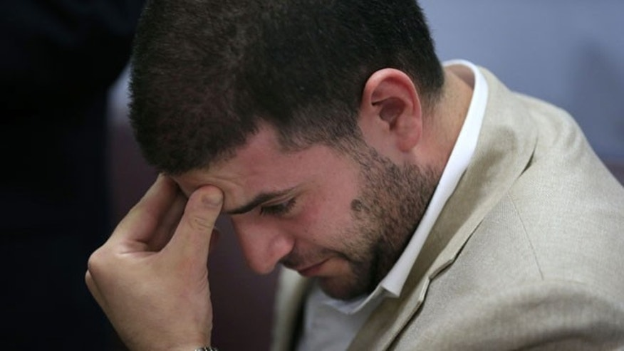 July 22, 2013: Osama Morsi, son of ousted Egyptian President Mohammed Morsi reacts during a press conference in Cairo
