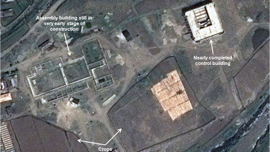 This May 26, 2013 satellite image taken by Astrium, and annotated and distributed by 38 North shows an unfinished new missile assembly building, top left, and control center, top right, at the Tonghae facility in North Korea. (AP Photo/Astrium - 38 North)