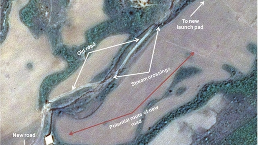 This May 26, 2013 satellite image taken by Astrium, and annotated and distributed by 38 North shows a new road to the new launch pad which also remains unfinished at the Tonghae facility in North Korea. (AP Photo/Astrium - 38 North)