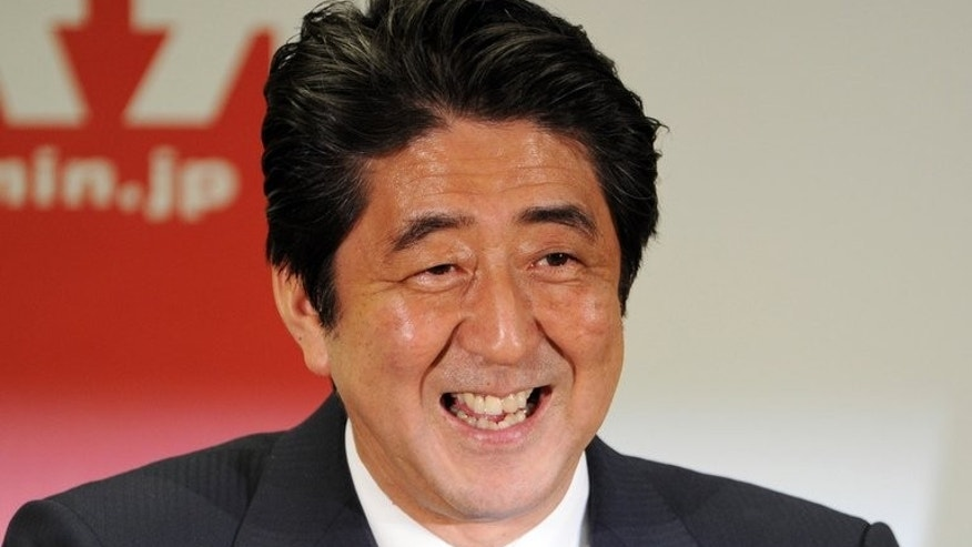 Japanese Prime Minister Shinzo Abe holds a press conference in Tokyo on July 22, 2013. Japan has formally joined negotiations for a US-led trans-Pacific agreement, raising hopes for a free trade deal which would cover nearly 40 percent of the global economy.