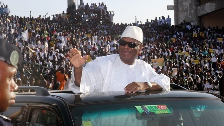 Former Malian Prime Minister and presidential candidate Ibrahim Bboubacar Keita arrives on July 7, 2013 at the 26 Mars stadium in Bamako to launch his election campaign. Keen to hand over its military role in Mali to the United Nations, France doggedly insisted that polls be held this month in the traumatised nation, despite difficulties in organising the vote.
