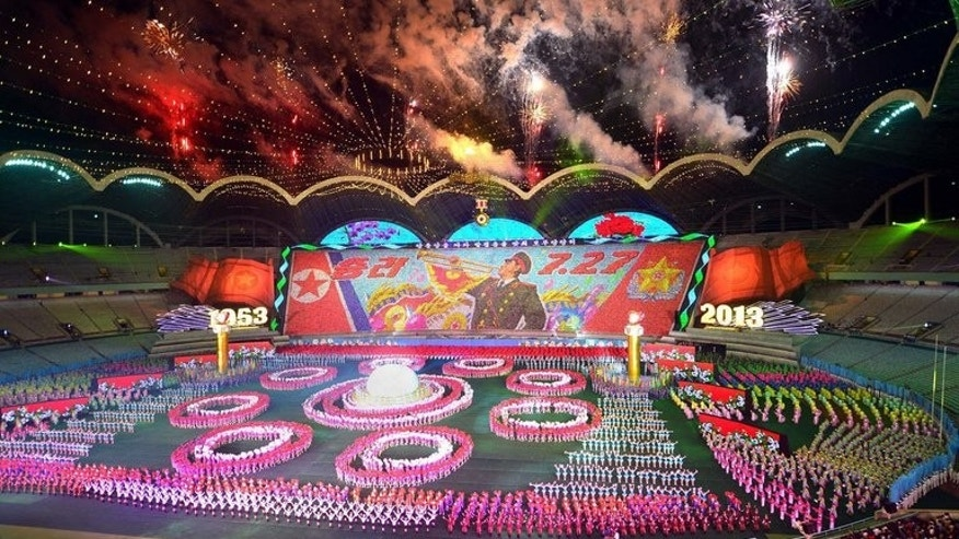 "This photo, taken by North Korea's official Korean Central News Agency (KCNA) on July 22, 2013, shows a mass gymnastic and artistic performance ""Arirang"" to mark the 60th anniversary of the end of the Korean War, held at the May Day stadium in Pyongyang."