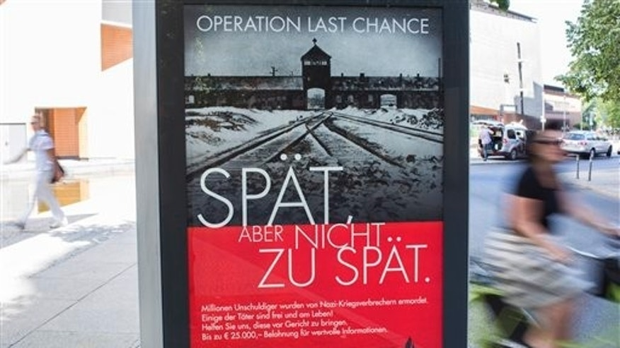 "July 23: A placard reading ""Operation last chance - late but not too late"" is displayed in Berlin, Germany. With 2,000 placards in Berlin, Hamburg and Cologne cities the Simon Wiesenthal Center launched another campaign to find and prosecute Nazi war criminals while they are still alive."