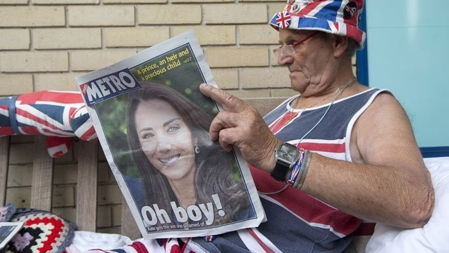 Royal supporter Terry Hutt reads a newspaper announcing the birth of the newest member of Britain's royal family outside St Mary's Hospital in Paddington, London, on July 23, 2013. Britain's new baby prince follows his father and late grandmother by being born under the zodiac sign of Cancer, suggesting he will be a strong leader, according to astrologists.