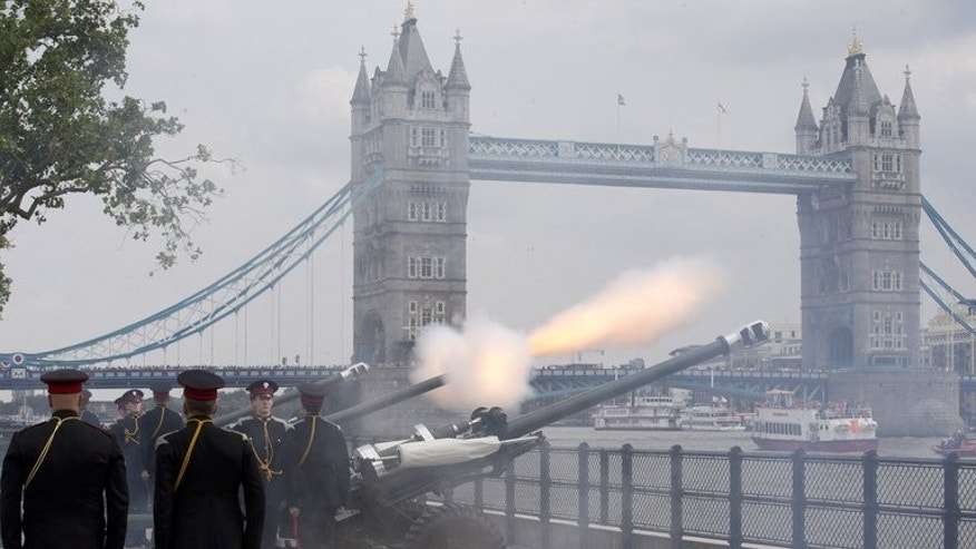 Members of the Honourable Artillery Company (HAC), the City of London???s Army Reserve Regiment, fire a 62 gun salute to mark the birth of a new royal baby at the Tower of London in central London on July 23, 2013.