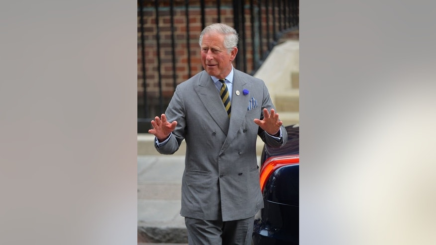 Prince Charles gestures as he leaves the St Mary's Hospital in London, on July 23, 2013.