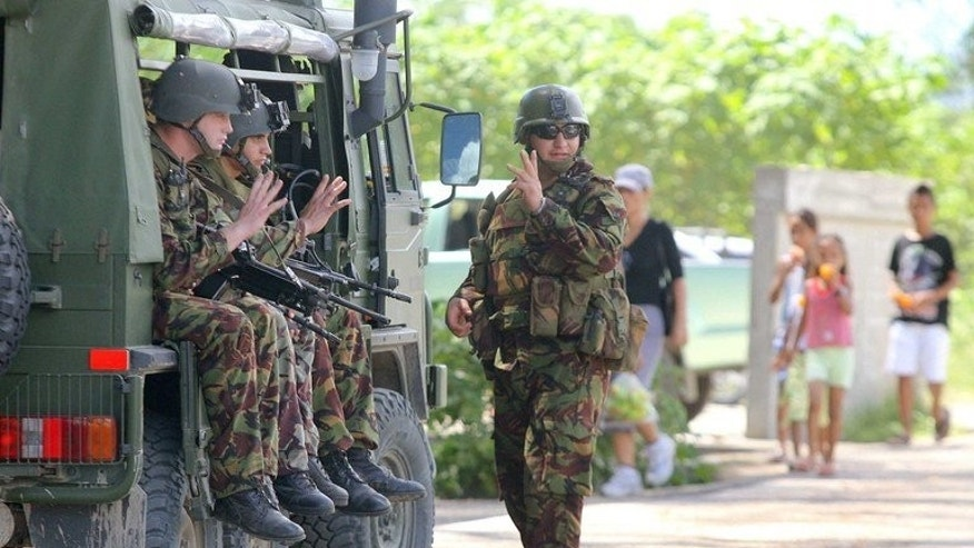New Zealand soldiers patrol the steets of Honiara, 23 April 2006. The largest military operation in the Pacific since World War II winds up in the Solomon Islands on Wednesday after a decade working to end deep-seated ethnic violence in the poverty-stricken nation.