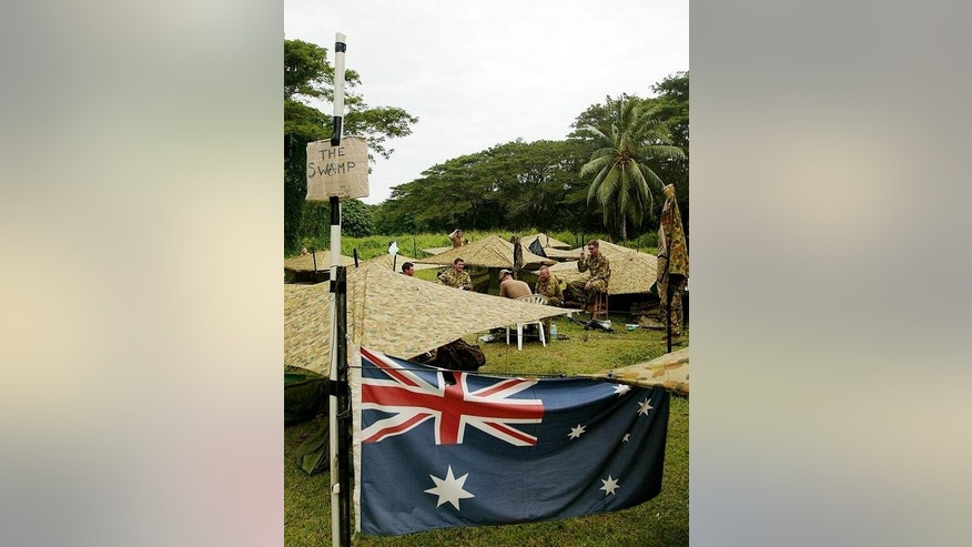 Australian troops set up a base camp near Honiara, 25 July 2003. The Regional Assistance Mission to the Solomon Islands (RAMSI) deployed in a fanfare of publicity in 2003 after a desperate appeal from Honiara for international assistance.