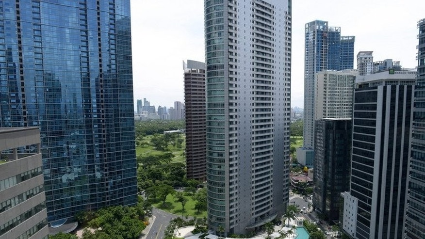 New office buildings in Manila, pictured on July 12, 2013. Dynamic growth and an expanding middle class are making Southeast Asian consumers among the most confident in the world when it comes to their economic prospects, a survey shows.