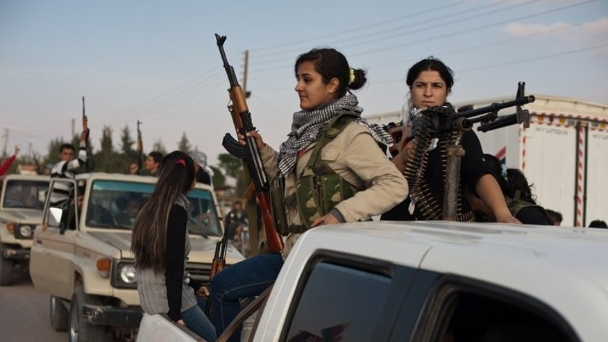 Kurdish anti-Syrian government activists parade the streets in Derik, near al-Malikiyah, on November 15, 2012. Syrian Kurds have made rapid advances in the north of the country, expelling jihadists from several villages, according to the Syrian Observatory for Human Rights.