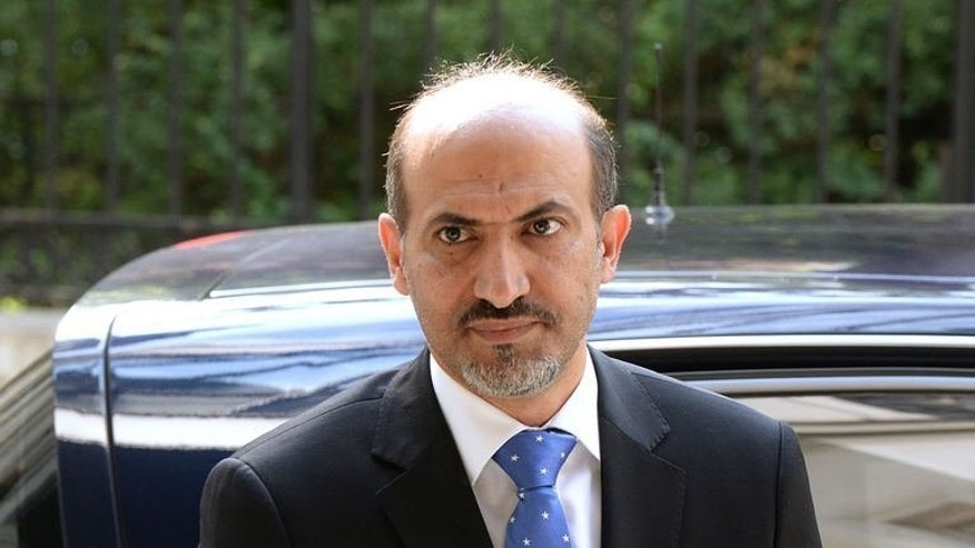 Syria's new opposition chief Ahmad Jarba arrives in Paris for a meeting with French national assembly Foreign Affairs committee on July 23, 2013, on the first of a two-day visit aimed at convincing France to boost its support for rebels battling Syria's President Bashar al-Assad.
