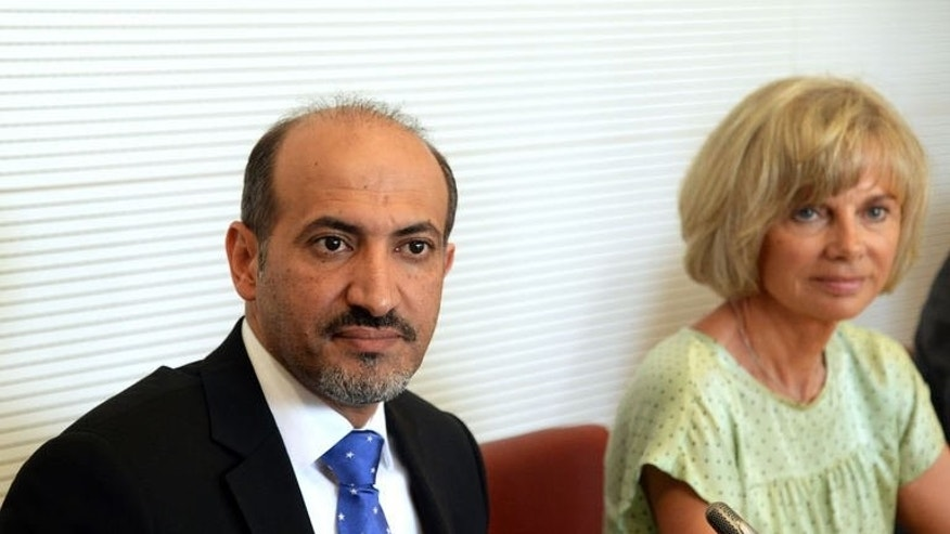 Syria's new opposition chief, Ahmad Jarba, is pictured next to Elisabeth Guigou, head of the French national assembly Foreign Affairs committee, before his hearing on July 23, 2013. It is the first of a two-day visit aimed at convincing France to boost its support for rebels battling the Syrian President.