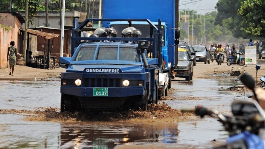 Security forces patrol in the streets of Lome, Togo, on June 7, 2013. Candidates in Togo's parliamentary elections made final pitches to voters Tuesday ahead of polls that will see the west African nation's opposition try to loosen the ruling family's decades-long grip on power.