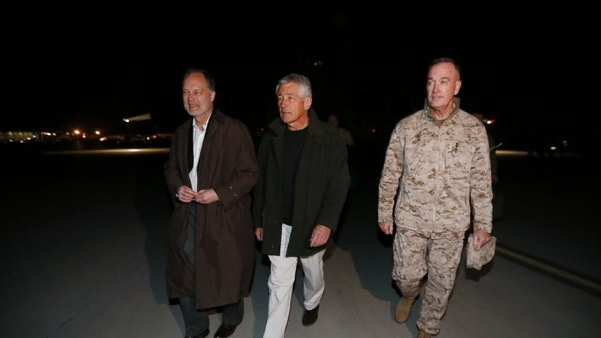 US Secretary of Defense Chuck Hagel (C) walks with US Ambassador to Afghanistan James Cunningham (L) and General Joseph Dunford, Commander of the International Security Force in Kabul, Afghanistan, on March 8, 2013. Cunningham said Tuesday that withdrawing from Afghanistan after 2014 and leaving behind no American troops was not in the interests of either country.