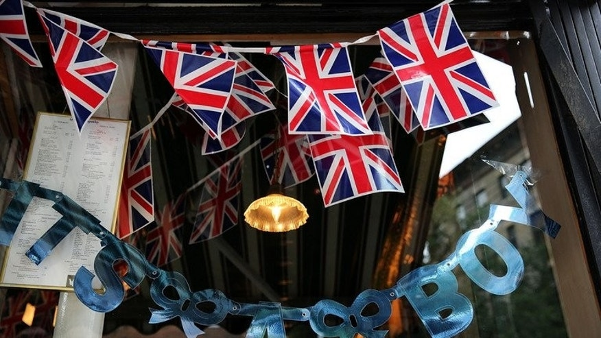 "A sign in the window of the British restaurant and grocery Tea & Sympathy reads. ""It's A Boy"" on July 22, 2013 in New York City as it celebrates the birth to Britain's Prince William and his wife Kate of their first baby"