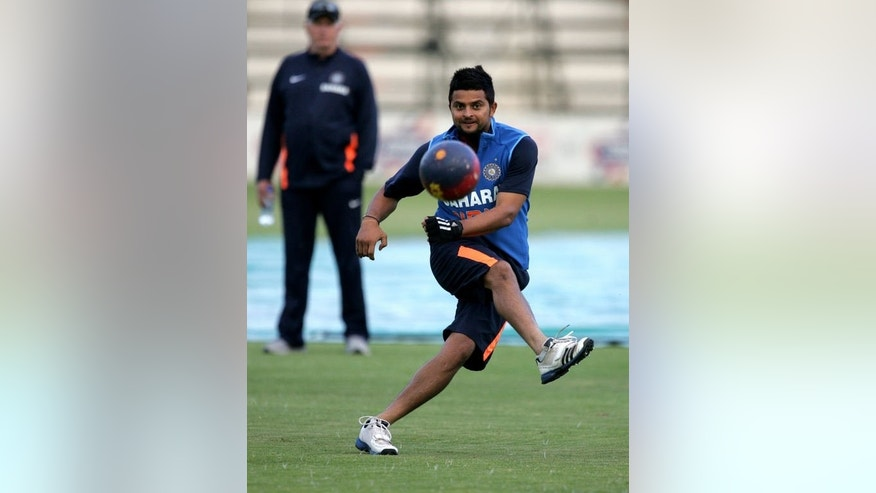 Indian cricketer Suresh Raina kicks a football during a practice session in Harare on July 22, 2013, ahead of a 5 match ODI series in Zimbabwe.
