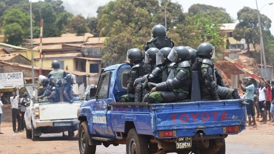 Guinea's Gendarmes patrol in the streets on May 2, 2013 in Conakry. At least 95 people died and around 100 more were wounded in ethnic violence last week in Guinea, a government spokesman said Wednesday, revising higher a previous toll of 58.