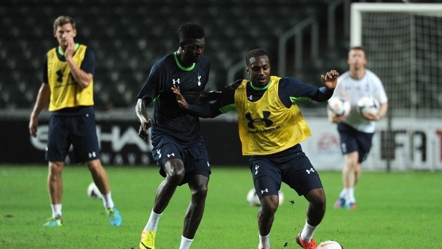 Tottenham Hotspur players compete for the ball during a training session at Hong Kong stadium on July 23, 2013. Hotspur legend Ledley King says Gareth Bale is happy at the club, as speculation intensifies about fierce interest from Real Madrid.