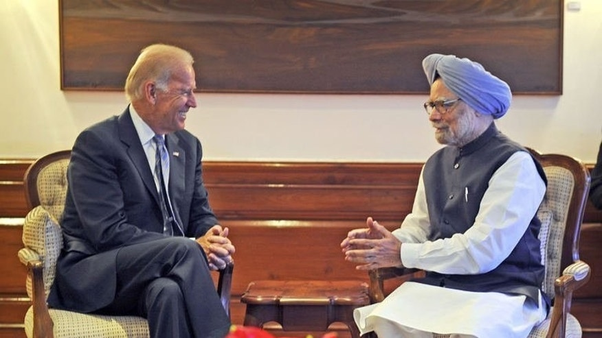Indian Prime Minister Manmohan Singh talks with US Vice President Joe Biden in New Delhi, on July 23, 2013. Biden is expected Wednesday to urge India to further open its doors to foreign investment, during his visit to boost bilateral ties between the world's two largest democracies.