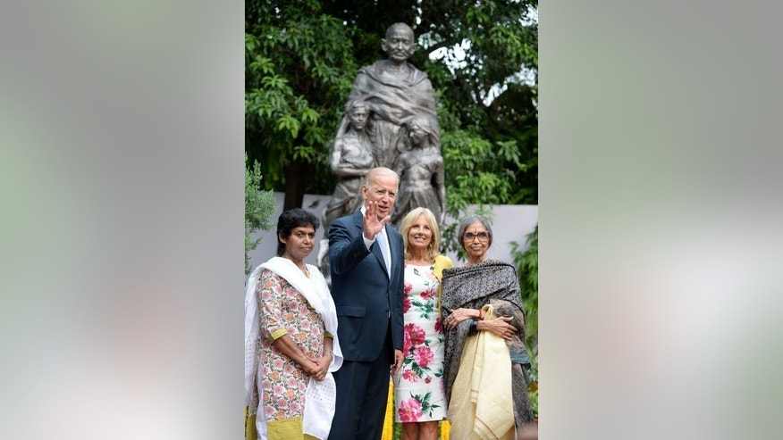 US Vice President Joe Biden poses in front of a statue of Mahatama Gandhi in New Delhi, on July 22, 2013. Biden is on a four-day visit designed to revive flagging diplomatic ties and fire up bilateral trade.