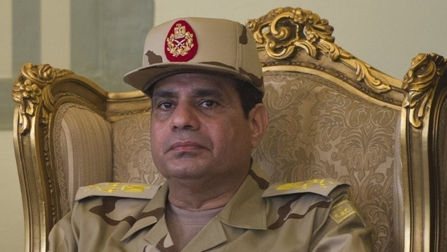 "Egypt's Army Chief Abdel Fattah al-Sisi attends a ceremony at the Almaza Airbase in Cairo, on May 22, 2013. Sisi has called for public rallies this week to give him a mandate to fight ""terrorism and violence,"" as Mohamed Morsi's supporters continue to protest against his ouster."