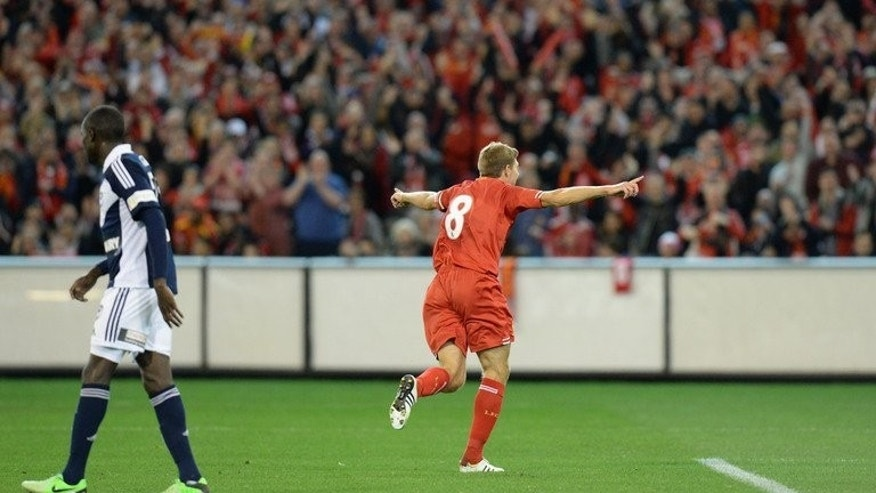 Steven Gerrard celebrates a goal against Melbourne Victory in Melbourne on Wednesday. Gerrard sent the 95,000 crowd home happy with a trademark goal in Liverpool's 2-0 win over Australia's Melbourne Victory at the Melbourne Cricket Ground on Wednesday.