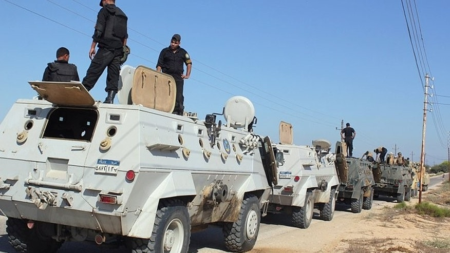 "Egyptian security forces stand on their armoured vehicles in the northern Sinai peninsula, on August 8, 2012. Gunmen have killed an Egyptian soldier in the restive Sinai, as the military chief called for mass rallies to back a crackdown on ""terrorism and violence""."