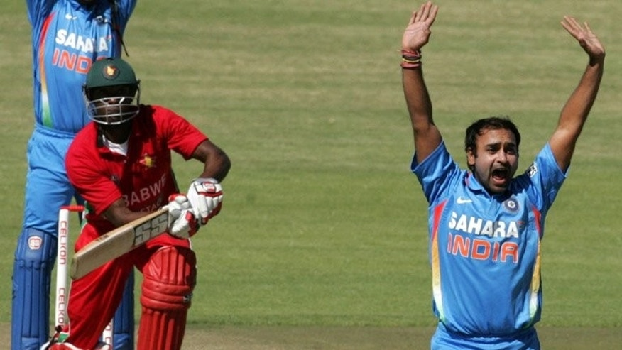 Amit Mishra appeals for the wicket of Zimbabwe's Vusimuzi Sibanda in Harare on Wednesday. Zimbabwe opener Sikandar Raza hit his maiden half-century in international cricket, but his contribution was outshone by Indian legspinner Amit Mishra's deceptive googly as Zimbabwe posted 228 for seven in the first one-day international on Wednesday.