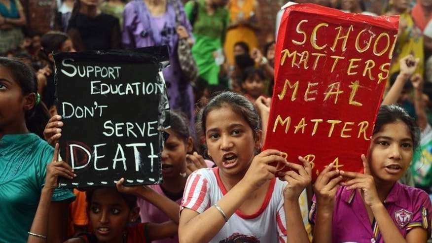 Indian children and activists shout anti-government slogans during a rally in New Delhi, on July 20, 2013. The rally was called following the death of 23 children in Bihar state after they ate poisoned school meals. Indian police have arrested the head of a school in eastern India where 23 students died after eating food tainted with pesticide, an officer told AFP.
