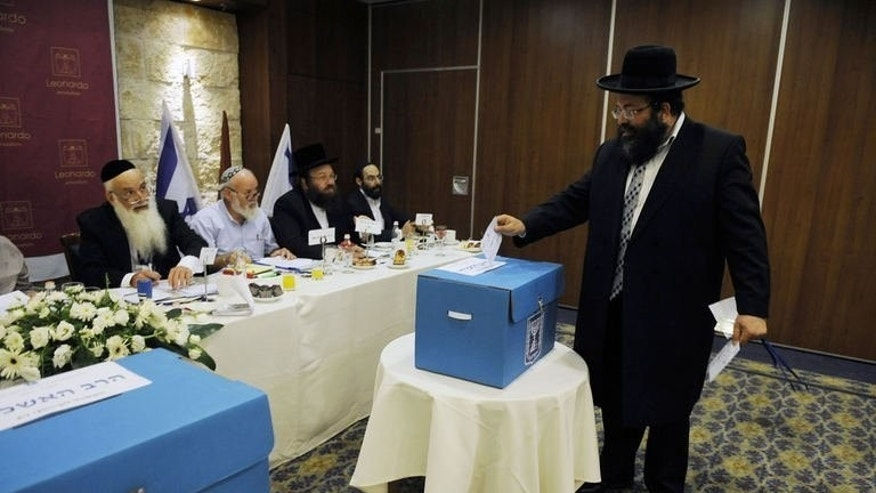 An ultra-orthodox Jew casts his ballot during the election for Israel's two chief rabbis held in Jerusalem on July 24, 2013. Two rabbis backed by ultra-orthodox parties were elected on Wednesday to serve as Israel's chief rabbis for the next 10 years, an official announcement says.