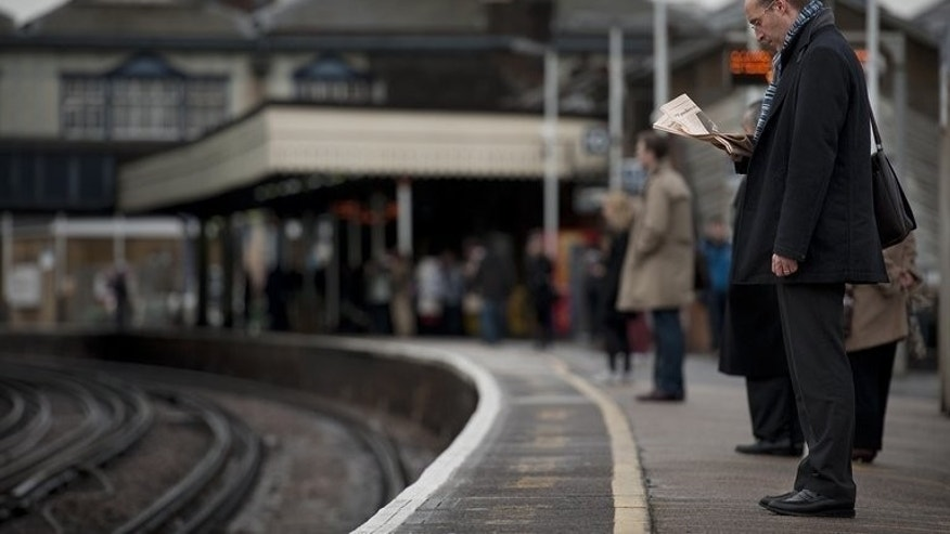 File picture taken on January 19, 2012 shows rail passengers waiting for a train on the platform at Clapham Junction station in south London. The latest challenge to the government's plans for the HS2 national high-speed rail project was rejected on Wednesday by the Court of Appeal.